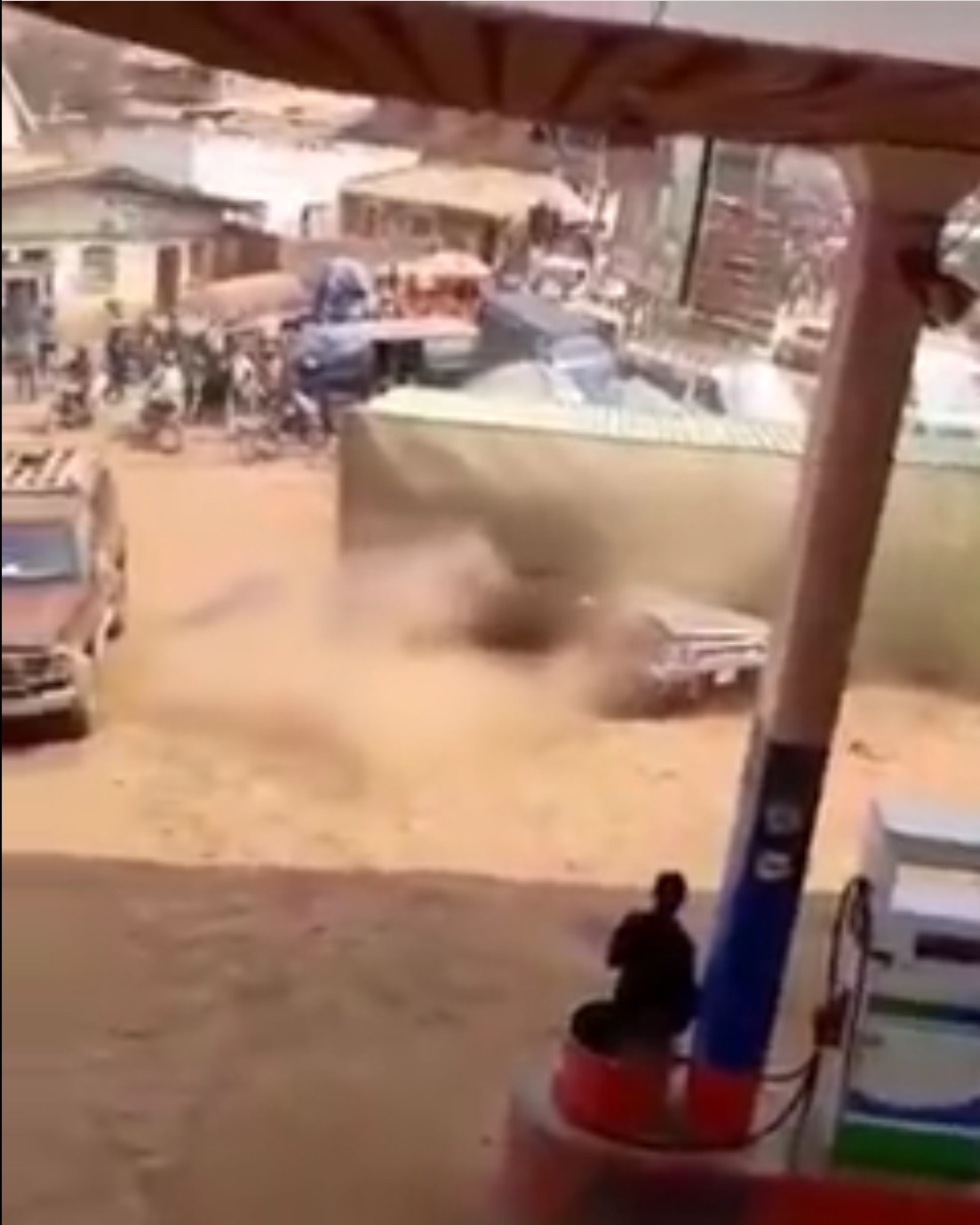 Watch The Moment A Container Fell On An SUV That Was Parked Beside It